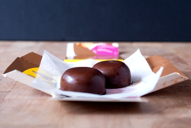 Picture of two bonbons in a small folded out box.