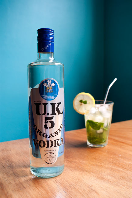 Picture featuring a bottle of Utkins UK5 vodka and a glass of lemon basil mojito.
