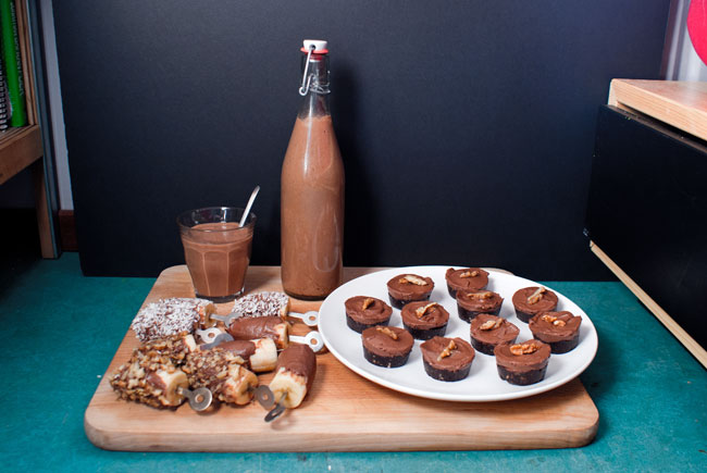 Picture of frozen banana popsicles, raw brownies and chocolate milkshake.